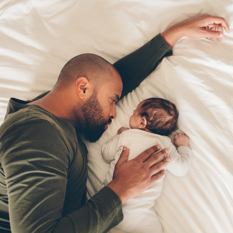 Dad and Baby on Bed