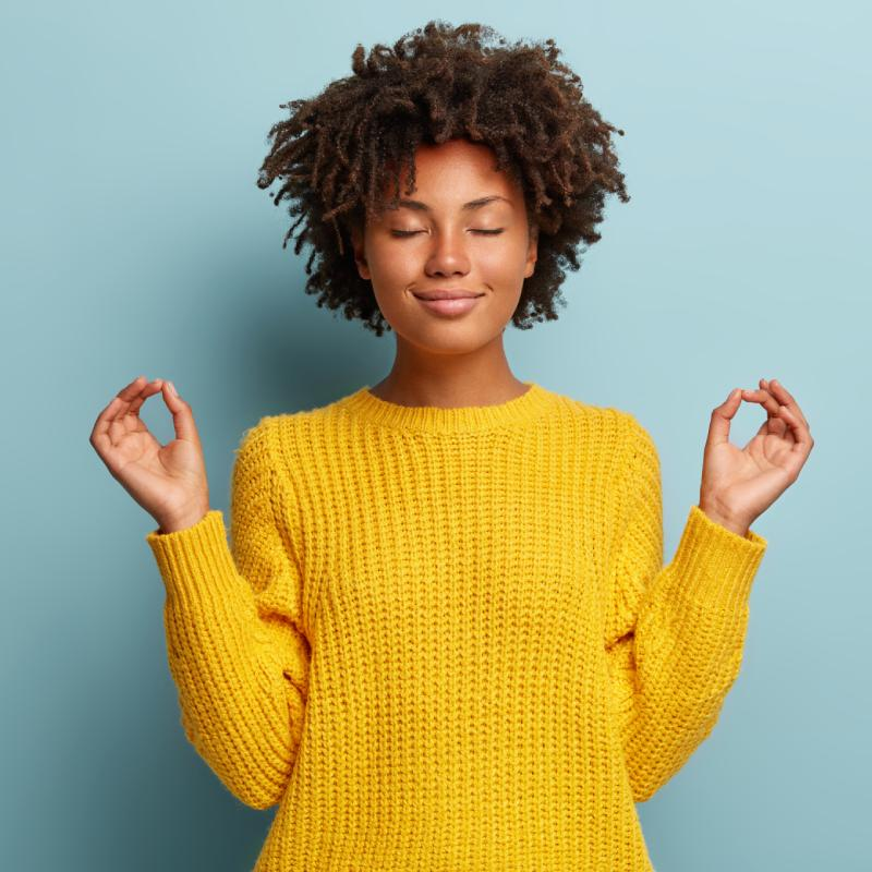Relaxed Woman in Yellow Sweater