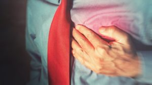 Man with hand on chest in pain